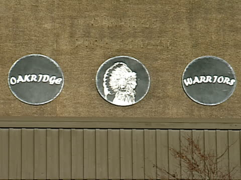 oakridge high school building, three circle plaques over entrance, native indian design . vs oakridge high school sign. vs entrance to building,... - mascot stock videos & royalty-free footage