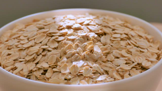 oat flakes, close up - oatmeal stock videos & royalty-free footage