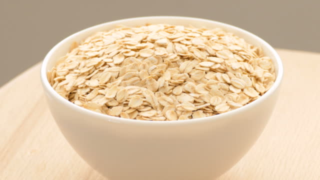 oat flakes in a bowl, close up - oatmeal stock videos & royalty-free footage