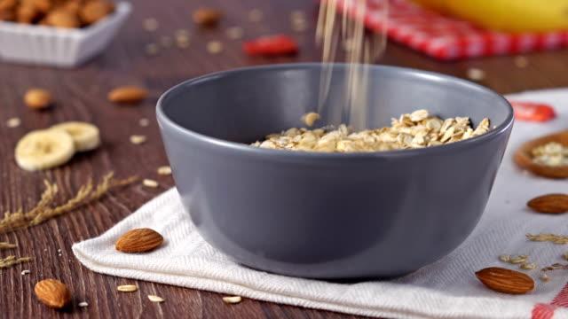 4k oat flakes - slip banana stock videos & royalty-free footage