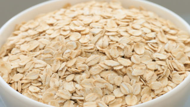 oat flakes - oatmeal stock videos & royalty-free footage