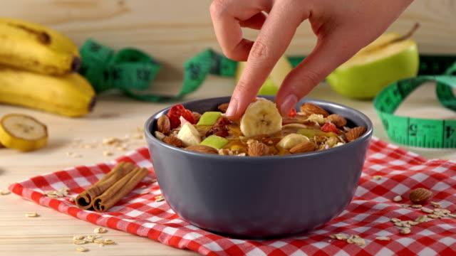 4k oat granola with pecan nuts, yogurt bowl - slip banana stock videos & royalty-free footage