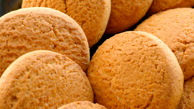 oatmeal cookies, close-up - biscuit stock videos and b-roll footage