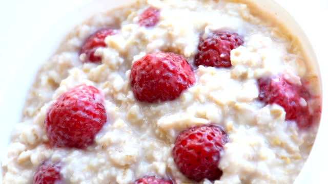 oatmeal porridge with strawberries - oatmeal stock videos & royalty-free footage