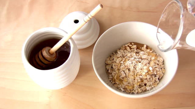 oatmeal with honey - oatmeal stock videos & royalty-free footage