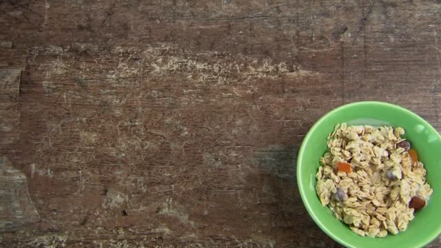 oatmeal with nuts and dried fruit - oatmeal stock videos & royalty-free footage