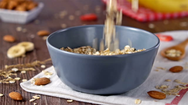 Oats and oat flakes in bowl