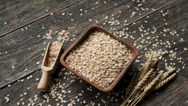 oats, oat flakes in wooden bowl - oatmeal stock videos & royalty-free footage