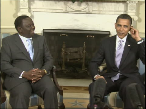 of obama and tsvangirai with microphones moving in the foreground zoom-in to mcu of obama and tsvangirai after a five-day trip to the united states,... - non us film location bildbanksvideor och videomaterial från bakom kulisserna