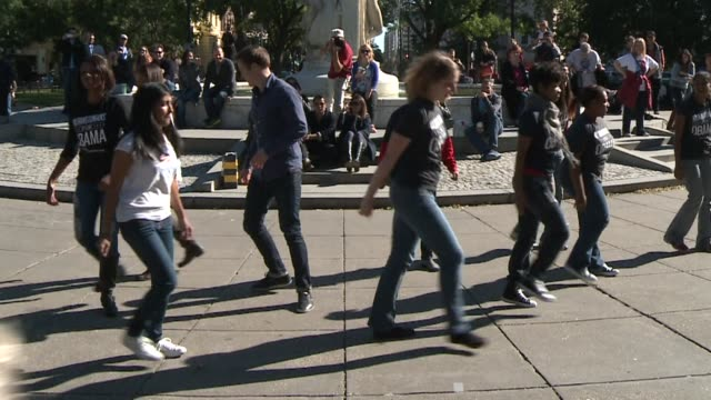 obama supporters staged simultaneous dance for obama flash mobs saturday set to a song that incorporates the presidents campaign logo forward in... - flash mob stock videos and b-roll footage