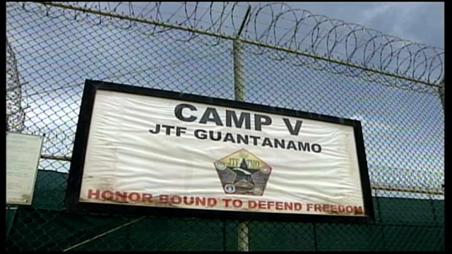 obama to 'prioritise' case of last british man in guantanamo bay r12090610 / 1292006 guantanamo bay naval base camp delta ext sign on wire fence camp... - soft focus stock videos & royalty-free footage