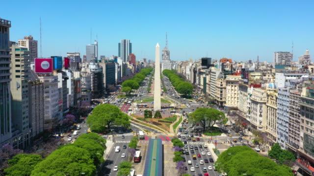 obelisk landmark in buenos aires and green letters ba - avenida 9 de julio stock videos & royalty-free footage