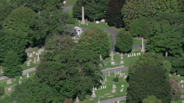 aerial obelisks and headstones in section of swan point cemetery / providence, rhode island, united states - breitwandformat stock-videos und b-roll-filmmaterial