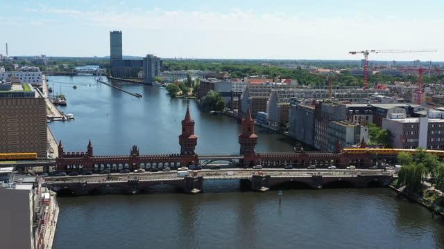 oberbaum bridge over spree river / berlin, germany - berlin stock videos & royalty-free footage