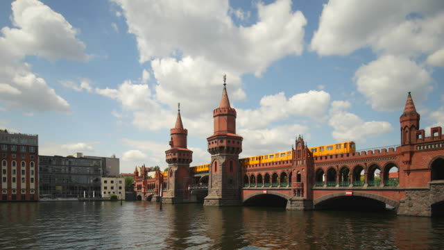 Oberbaumbrücke Berlin in Summer with Spree River, Train and Cloud Dynamic