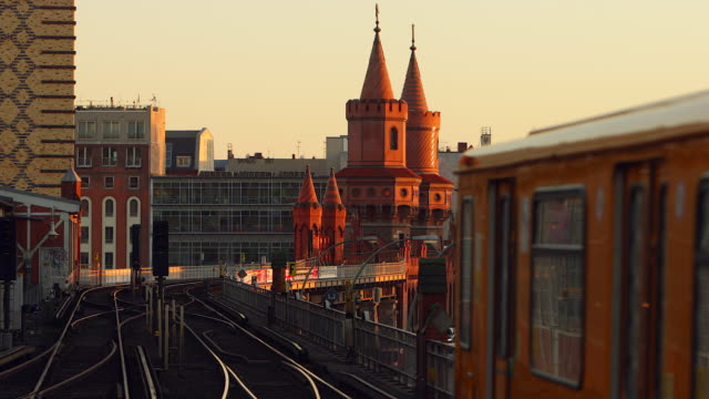 Oberbaumbrücke Berlin in Summer with Sunset and Train Dynamic