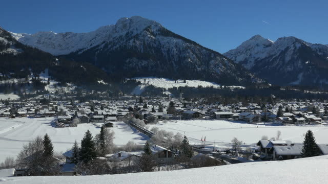 oberstdorf with allgaeu alps in winter, swabia, bavaria, germany - pinaceae stock videos & royalty-free footage