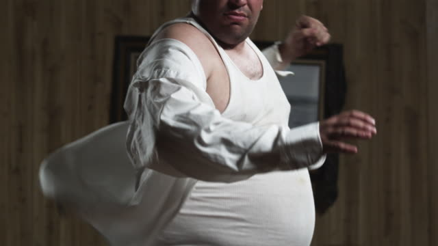 ms tu slo mo obese man dancing in living room / orem, utah, usa - overweight stock-videos und b-roll-filmmaterial