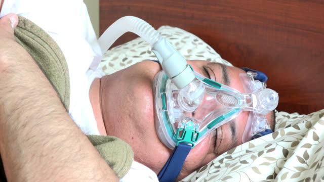 obese man suffering from sleep apnea - sleep apnea stock videos and b-roll footage