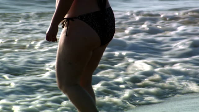 obese woman standing in water in bikini - large stock videos & royalty-free footage