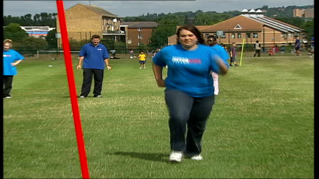 fitter kids camp for overweight children opens in london **robbie williams music overlaid over following sequence sot** boy punching padded gloves of... - participant stock videos & royalty-free footage