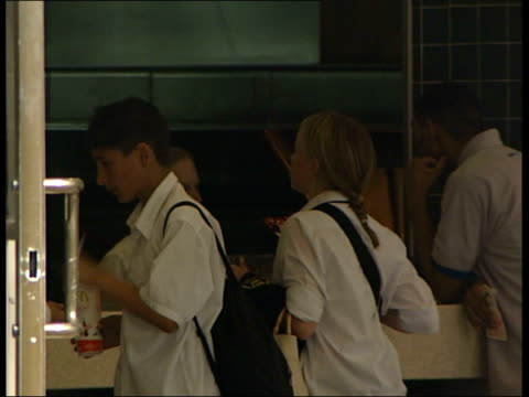 obesity in children date bv schoolchildren stand at mcdonald's counter one boy holds mcdonalds drinks carton ext cms schoolgirl holding mcdonald's... - mcdonald's stock videos and b-roll footage