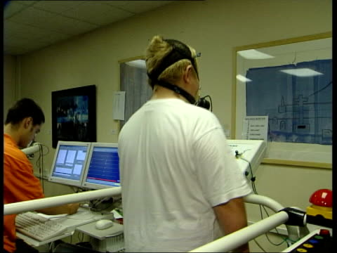 new treatment news at ten lawrence mcginty lib fat youth walking on treadmill tilt cms fat youth wearing oxygen mask whilst walking on treadmill cs... - oxygen mask stock videos and b-roll footage