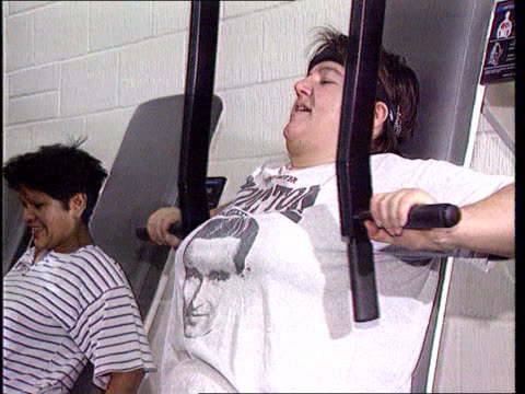 ben lib england london over weight women on various exercise machines cms fat woman seated on exercise machine la ms obese woman on thigh exerciser... - aerobics stock videos and b-roll footage