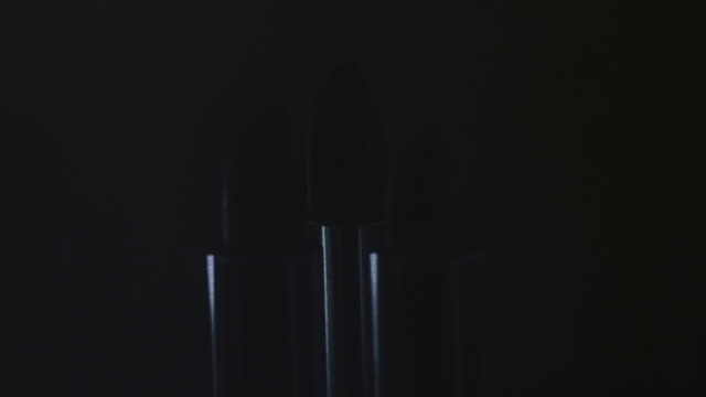 Objects Rotating lipsticks from dark to bright