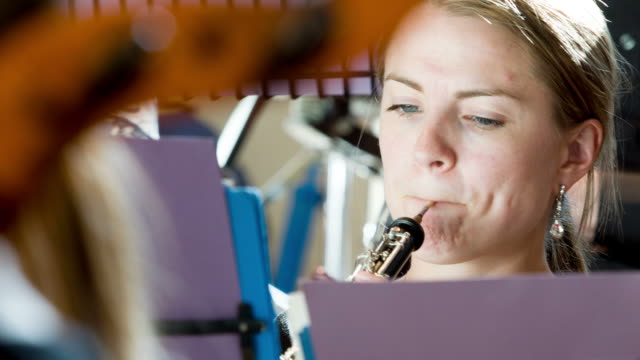 oboe player in orchestra - rehearsal stock videos & royalty-free footage