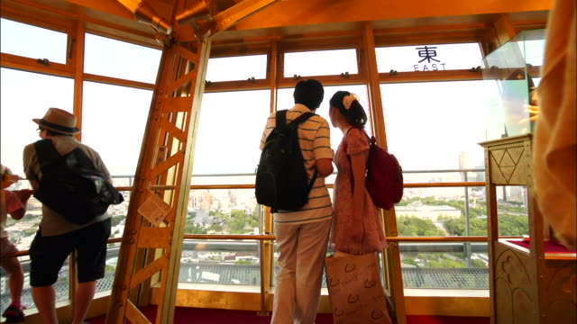 pov; observation deck of tsutenkaku tower, osaka, japan - randoseru stock videos & royalty-free footage