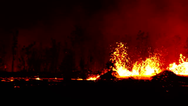observing fissure 20 fountaining at varied heights up to 50 feet feeding a massive channel of pahoehoe lava flowing east toward pohoiki at speeds up... - the center stock videos and b-roll footage