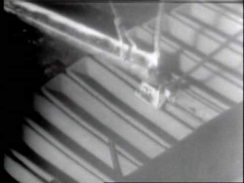 obsolete b47 bombers are destroyed by heavy weights with pieces fed into a furnace which produces aluminum ingots - guillotine stock videos & royalty-free footage