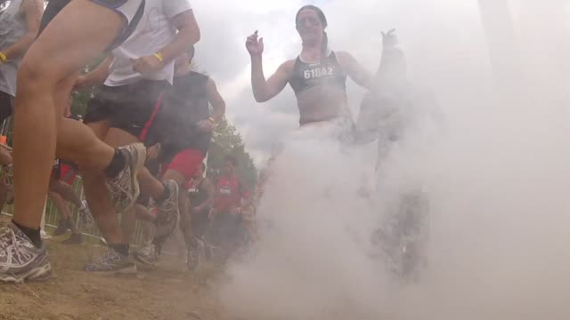 obstacle race spartan entrants pushed to limits start through for field - salmini stock videos and b-roll footage