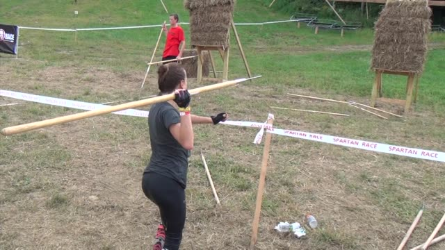 obstacle race spartan entrants pushed to limits throwing javelin spear - salmini stock videos and b-roll footage