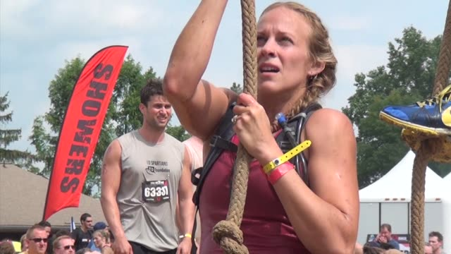 obstacle race spartan entrants pushed to limits women on rope - salmini stock videos and b-roll footage
