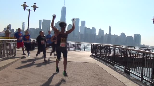 Obstacle Racers enjoy the challenge of the waterfront course in Jersey City