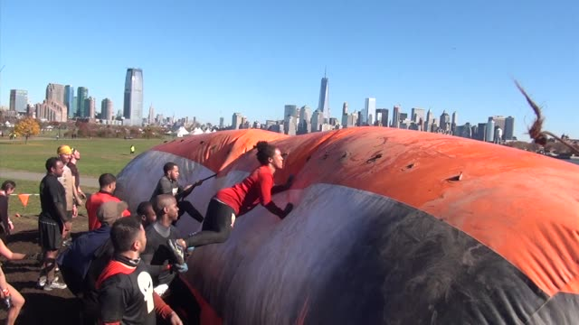 Obstacle racers take on a variety of challenges in Liberty State Park in New Jersey across from One World Trade Center and lower Manhattan