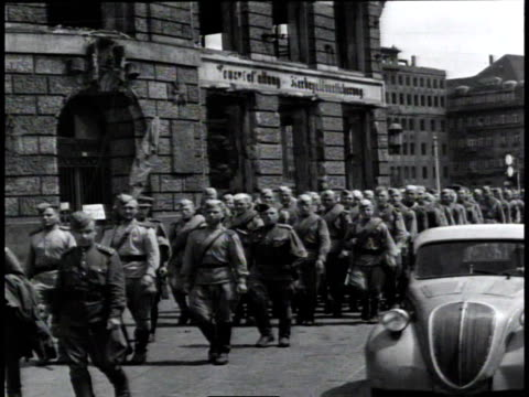 occupation troops marching in berlin, car driving past on the street / germany - postwar stock videos & royalty-free footage