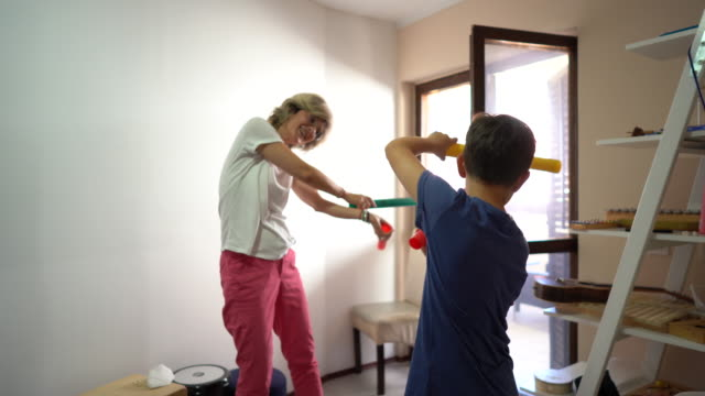 occupational therapist and boy playing with plastic tubes at rehabilitation center - invisible disability stock videos & royalty-free footage