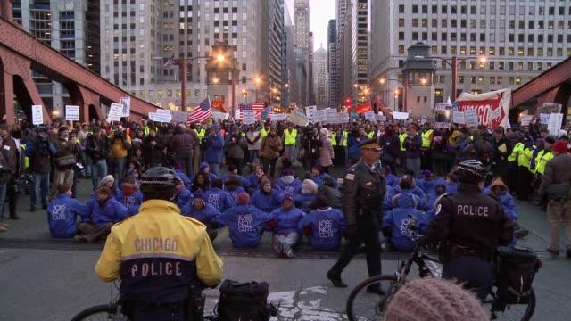 Occupy Chicago shuts down La Salle Street bridge in downtown Chicago November 17 2011 / Protestors at Daley Plaza / protestors at La Salle street...