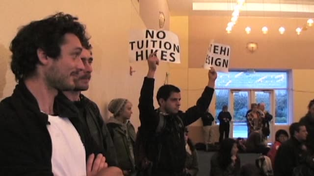occupy davis protesters voiced their concerns over tuition hikes and police brutality on monday morning at a university of california regents'... - university of california bildbanksvideor och videomaterial från bakom kulisserna