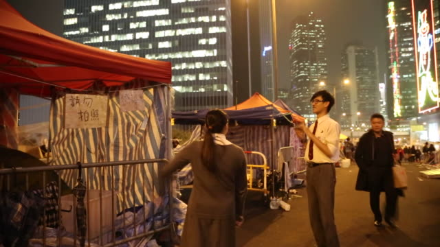 occupy hong kong protesters on a highway in hong kong china on december 10 wide shots and close ups of pedestrians taking pictures of occupy hong... - occupy central stock videos & royalty-free footage