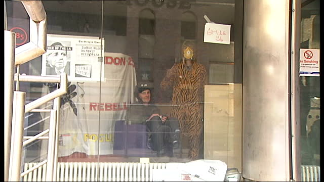 occupy london protesters occupy roman house england london ext banner reading occupy everywhere placed in windows of the roman house office block by... - legal occupation stock videos and b-roll footage