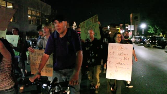 occupy wall street protesters march on kirkwood avenue in bloomington indiana at the beginning of a protest that would last until january when police... - 2011 stock videos & royalty-free footage