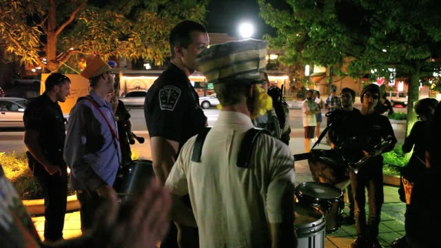 occupy wall street protesters march on kirkwood avenue in bloomington indiana at the beginning of a protest that would last until january when police... - 立ち退き点の映像素材/bロール