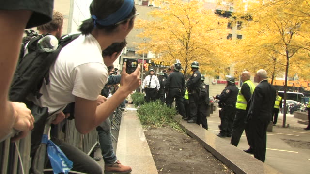 occupy wall street protesters rally to try to get back into zuccotti park after nypd officers kick them off the property during an early morning... - occupy protests stock videos & royalty-free footage