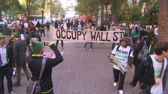 occupy wall street protestors call for a robin hood tax on the wealthy on its two year anniversary at zuccotti park on september 17, 2013 in new... - occupy protests stock videos & royalty-free footage