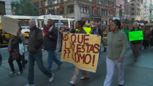 occupy wall street protestors march on the streets of manhattan during a sunny afternoon on november 1st occupy protestors march with signs targeting... - andrew cuomo stock videos and b-roll footage