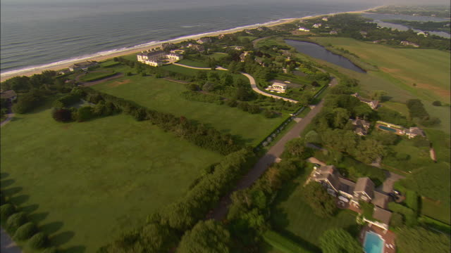 aerial, ocean and mansions at  lily pond lane, east hampton, new york, usa - long island stock videos & royalty-free footage